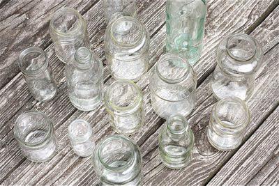 Пустые бутылки под вазы Фото