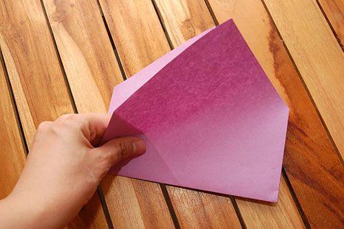 Сложите квадрат, получив форму дома Фото