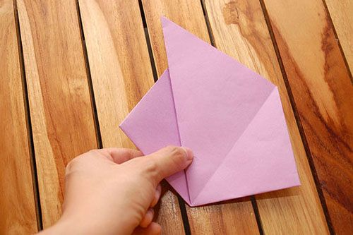 Выдвините треугольник слева Фото