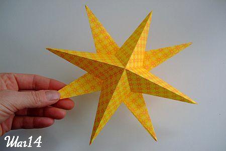 Двойная звезда из бумаги готова фото
